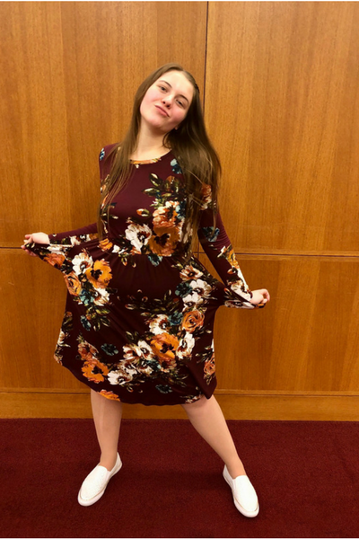 Showing off the fact that the dress has pockets